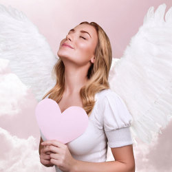 image of beautiful angel woman holding heart