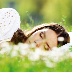image of woman sleeping on the grass