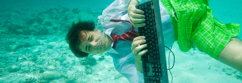 image of man with computer under the water