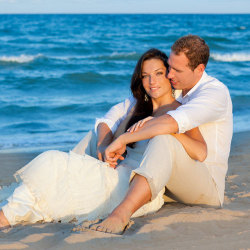 image of couple relaxing and in love on the beach