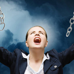 image of woman breaking free from chains
