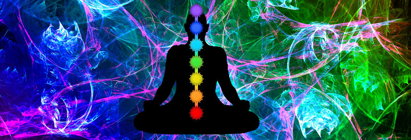 image of the chakras on meditating silhouette