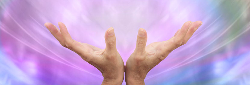 image of reiki healing hands in bright light