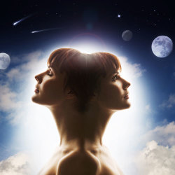 woman with 2 faces looking at the moons