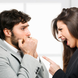 image of man looking afraid of a woman berating him