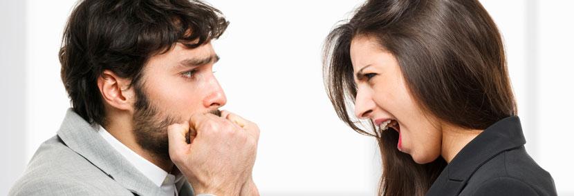 image of man looking afraid of a woman berating him