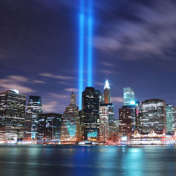 image of new york city with a beaming light coming from the world trade centre memorial