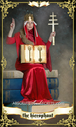 image of a woman holding a candle sitting on books