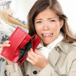 image of crying woman with an empty purse