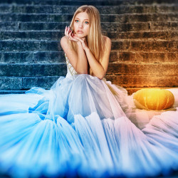 image of cinderella sitting on the steps with a pumpkin