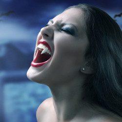 image of beautiful vampire woman in the moonlight