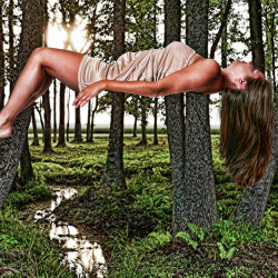 image of woman falling in the sky in the forest