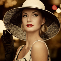 image of elegant woman wearing hat and black and white dress