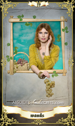image of woman holding grapes outside a window