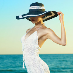 image of woman wearing lace dress and hat representing a libra woman