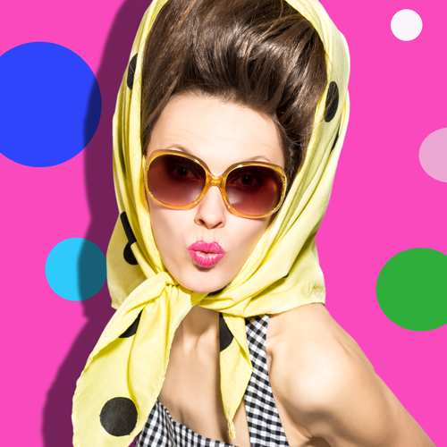 image of quirky woman wearing scarf with checkered dress