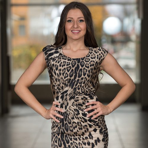 image of sagittarius woman wearing leopard print dress