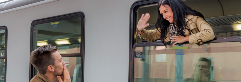 long distance relationship image of woman waving goodbye to her partner from a train