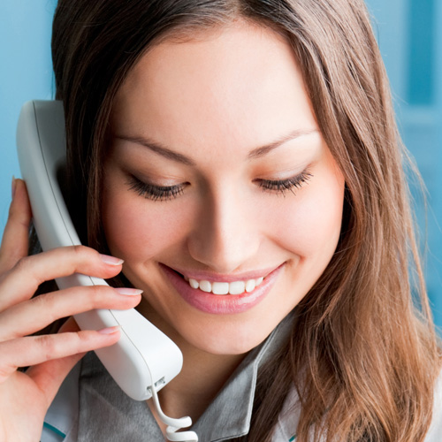image of woman happy talking on the phone to a psychic