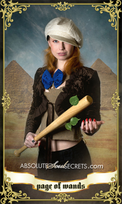 image of woman wearing a cap and holding a baseball bat