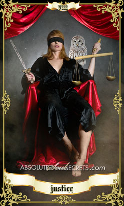 woman sitting blindfolded holding scales representing the Justice tarot card