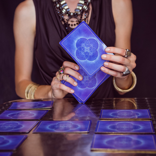 image of psychic laying out tarot cards