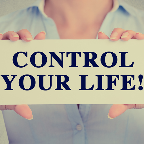 image of woman holding sign control your life