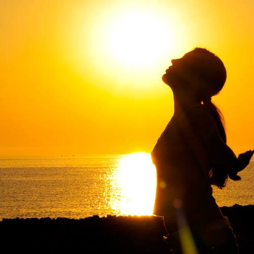 image of woman embracing an easy life in the sunset