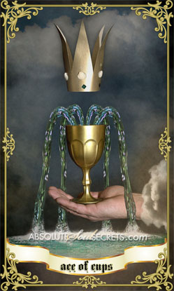 image of a hand holding the ace of cups
