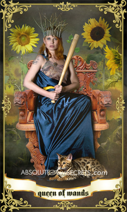 image of a queen in silk dress holding a wand representing the queen of wands tarot