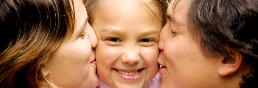 image of a child with both parents happy to be her parents