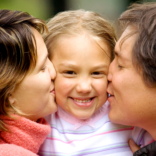 image of a beautiful child happy with both her parents who are co-parenting