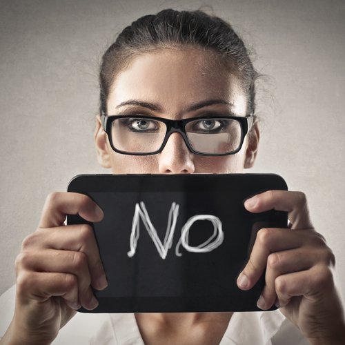 image of business woman holding a sign saying no