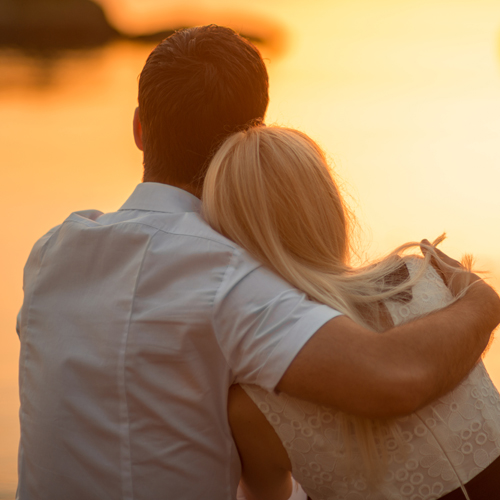 image of couple looking at the sunset enjoying each others company