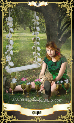 image of woman in a green dress in the garden surrounded by the 6 of cups