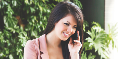 image of woman on the phone talking to a psychic at Absolute Soul Secrets