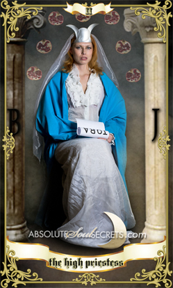 image of beautiful woman in blue cloak representing the high priestess tarot card