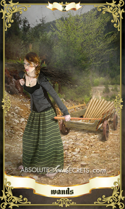 image of a beautiful red haired lady dragging a cart representing the 10 of wands