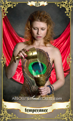 image of beautiful woman pouring water into a gold goblet representing the temperance tarot card