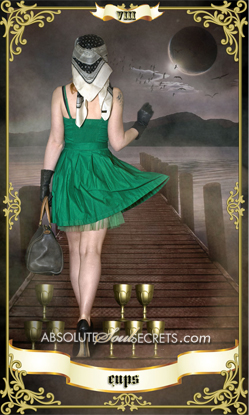 image of woman in a green dress surrounded by the 8 of cups