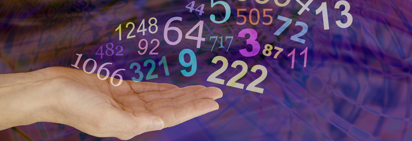 image of numbers flowing from a hand representing numerology number 1 year
