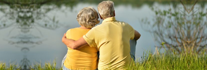 image of a happy senior couple looking at a lake