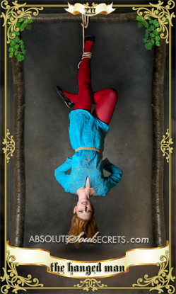 image of a woman hanging upside down suspended from the ceiling