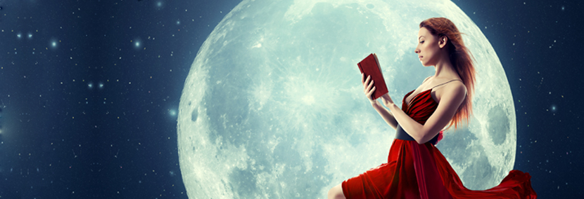 image of a woman in a red dress reading astrololgy in front of an eclipse moon