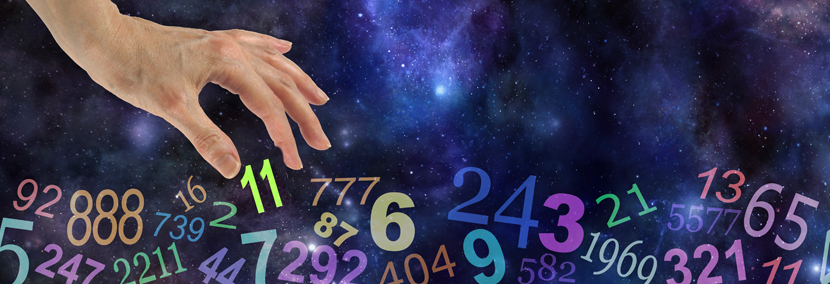 image of a hand picking up the number 11 numerology in a galactic space